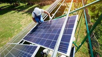 worker on solar panels
